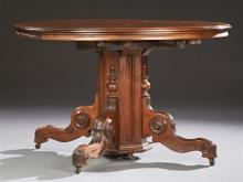 American Victorian Carved Mahogany Circular Dining Table, late 19th c., the stepped top to an octagonal support on quadruped scrolle...