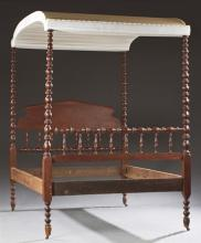 American Carved Mahogany Jenny Lind Tester Bed. c. 1900, the arched tester on spool turned posts flanking a peaked spindle headboard...
