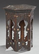 Moroccan Mother-of-Pearl Inlaid Tabouret, early 20th c., the hexagonal top over sides with arched cutouts, H.- 21 in., Dia.- 14 1/4 in.