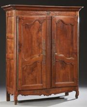 French Louis XV Style Carved Cherry Armoire, 19th c., the stepped canted corner ogee crown over double cupboard doors with long stee...