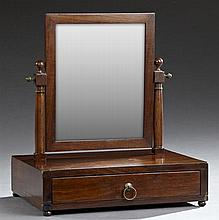 Carved Mahogany Dressing Mirror, 19th c., the rectangular mirror on turned tapered supports, to a base with a deep drawer, the whole...