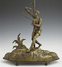 Gilt Spelter Figural Table Lamp, c. 1900, of a man battling a serpent, H.- 20 3/4 in., W.- 13 in., D.- 6 3/4 in.