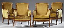 Set of Four Empire Style Carved Cherry Bergeres, early 20th c., the curved crest rail over an upholstered back, to upholstered scrol...