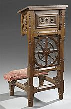 Gothic Revival Carved Oak Prie Dieu, late 19th c., the tiger oak top with a bible stand, above a recessed shelf, a pierced carved ba...