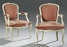Pair of Louis XV Style Carved Fauteuils, early 20th c., the carved floral carved crest over an upholstered shield form back, to upho...