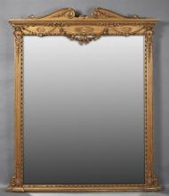 Ametrican Louis XVI Style Gilt and Gesso Overmantle Mirrot, early 20th c., the double scrolled crest over a stepped crown above appl...