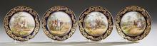 Set of Four French Sevres Style Hand Painted Porcelain Cabinet Plates, late 18th c., with a cobalt ground and raised gilt scrollwork...