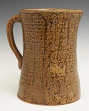 Stoneware Jug, 19th c., probably Sand Mountain Alabama, with a brown tobacco glaze, H.- 8 3/8 in., W.- 7 1/2 in., D.- 5 3/4 in.