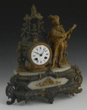 Gilt Spelter and Onyx Figural Mantel Clock, 29th c., with a figure of a troubadour beside the drum clock, the enamel dial marked