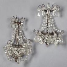 Near Pair of Brass Appliques, early 20th c., the scrolled spray tops hung with prisms and prism chains, to a lower crown form galler...