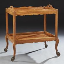 French lnlaid Walnut Dessert Cart, c. 1930, the top with a removable serving tray, on square legs, joined by a lower inlaid shelf, o...
