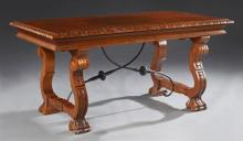 Spanish Style Carved Mahogany Coffee Table, 20th c., the stepped top on scrolled trestle supports on paw feet, joined by iron stretc...