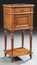French Louis XVI Style Marble Top Nightstand, early 20th c., the inset highly figured brown marble over a frieze drawer and a pot cu...