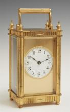 English Gilt Brass Carriage Clock, 19th c., with an enamel dial, running, H.- 5 1/2 in., W.- 3 1/8 in., D.- 2 5/8 in.