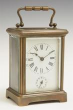 French Brass Carriage Alarm Clock, early 20th c., with beveled glass top and sides, running, H.- 4 3/8 in., W.- 3 1/8 in., D.- 2 1/2...