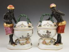 Pair of German Porcelain Meissen Style Blackamoor Covered Sweetmeat Bowls, early 20th c., the blackamoor figures standing next to a...