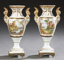 Pair of French Paris Porcelain Baluster Vases, 20th c., by Couleuvre, with gilt decoration and applied gilt handles of classical war...