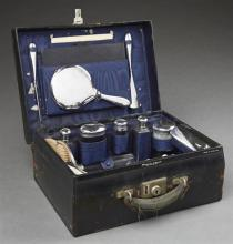 Lady''s Nineteen-Piece Sterling Silver-Mounted Necessaire de Voyage, the silver mounts hallmarked London, 1924-1926, by Corke Brother..