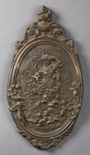 Unusual Oval Patinated Bronze French Style Wall Plaque, 20th c., the top with a relief fruited urn surmount over a relief scene of a...