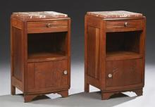 Pair of French Carved Oak Bowfront Marble Top Nightstands, c. 1920, the highly figured rouge marbles over a frieze drawer, open stor...