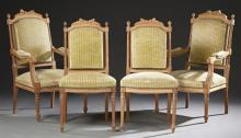 Four Piece French Carved Cherry Louis XVI Style Partial Parlor Suite, early 20th c., consisting of two fauteuils and two side chairs...
