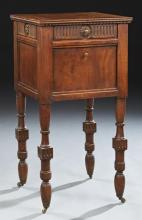 French Henri II Carved Walnut Nightstand, c. 1900, the grooved edge top over a frieze drawer and a fall front pot cupboard, on turne...