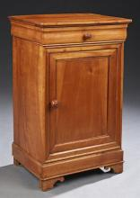 French Louis Philippe Style Carved Cherry Nightstand, c. 1920, the rectangular top over a cavetto frieze drawer above a cupboard doo...