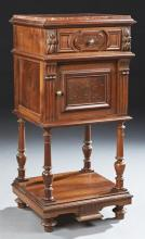 French Henri II Style Carved Walnut Marble Top Nightstand, c. 1880, the inset highly figured rouge marble over a frieze drawer and a...