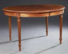 French Louis XVI Style Carved Mahogany Oval Dining Table, 20th c., the stepped edge top over a wide skirt, on turned tapered reeded...