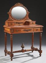 French Louis XVI Style Carved Walnut Marble Top Dressing Table, early 20th c., the oval beveled mirror over two glove drawers on a b...