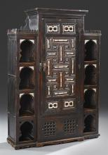 Moroccan Style Pine Cabinet, late 19th c., inlaid with bone with a center section with a long door over a drawer flanked by four bon...