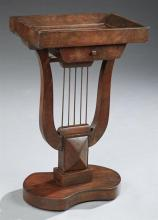 Regency Style Carved Mahogany Lyre Base Side Table, early 20th c., the dished rectangular top over a frieze drawer on a lyre form su...