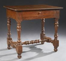 French Carved Walnut Louis XIII Style Writing Table, 19th c., the reeded rectangular top over a frieze drawer, on turned and block l...