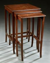 Nest of Three Art Nouveau Marquetry Inlaid Mahogany Side Tables, c. 1900, the rectangular tops with inlaid foliate decoration on squ...