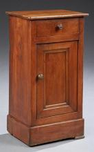 French Louis Philippe Carved Cherry Nightstand, 19th c., the rectangular top over a frieze drawer above a cupboard door, on a plinth...