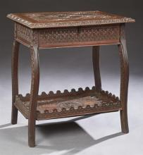American Arts and Crafts Carved Cherry and Walnut Desk, early 20th c., possibly Cincinnati, the geometric pinwheel lift top over ope...