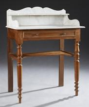 French Louis Philippe Carved Walnut Marble Top Washstand, 19th c., the figured white marble top with an arched marble backsplash and...