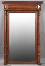 French Henri II Carved Walnut Overmantel Mirror, late 19th c., the stepped ogee crown over a wide beveled rectangular plate, flanked...