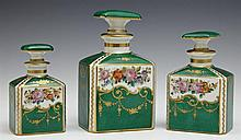 Graduated Set of Three Old Paris Porcelain Perfume Bottles, 19th c., on a green ground with gilt tracery and painted floral decorati...