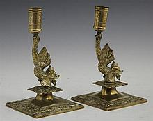 Pair of Heavy Bronze Dolphin Form Candlesticks, 19th c., on square bases decorated with relief fish, H.- 8 in., W.- 4 1/2 in., D.- 4...