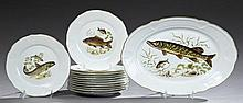 Thirteen Piece Limoges Porcelain Fish Set, 20th c., consisting of twelve plates and a platter, each with transfer decoration of fish...