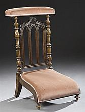 French Gothic Revival Carved Walnut Prie Dieu, late 19th c., the upholstered arm rest over a pierced lancet back with trefoils, flan...