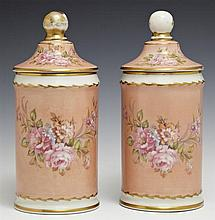 Pair of Porcelain Covered Apothecary Jars, early 20th c., with gilt and floral hand painted decoration, H.- 9 in., Dia.- 3 7/8 in.
