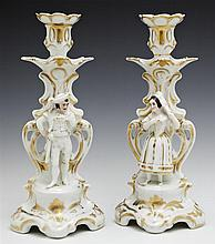 Pair of Continental Old Paris Style Figural Candlesticks, 19th c., with gilt decoration, H.- 10 1/2 in., W.- 4 5/8 in., D.- 4 in.