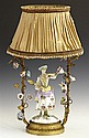 Meissen Style Porcelain and Bronze Figural Boudoir Lamp, early 20th c., with a central female figure standing in a bower mounted wit...