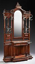 Large French Henri II Style Carved Walnut Marble Top Hall Stand, c. 1890, the arched top over a central arched wide beveled mirror f...