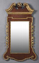 Chippendale Style Gilt and Gesso Mahogany Overmantel Mirror, early 20th c., the wide mahogany frame with a broken arch crest with a...