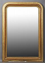French Louis Philippe Gilt and Gesso Pine Overmantel Mirror, 19th c., the arched frame with a beaded liner over an arched plate, H.-...