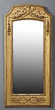 French Louis XVI Style Gilt and Gesso Pine Overmantel Mirror, early 20th c., the arched top over a torch and quiver frieze above a w...
