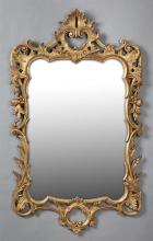 Continental Gilt and Gesso Overmantle Mirror, late 19th c., with a pierced curved shell form crest over a pierced frame with relief...